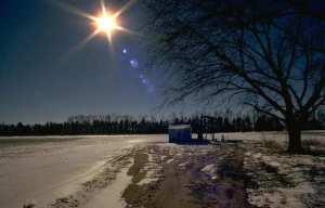 Snowy road, sun